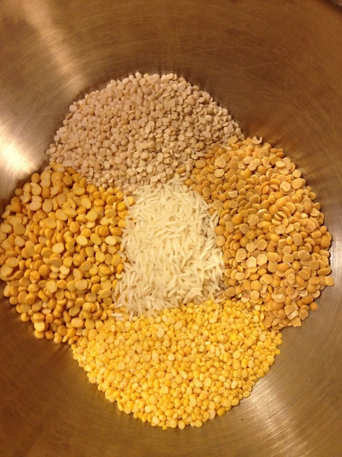 Clockwise from the top: Urad Dal, Toor Dal, Moong Dal, Chana Dal. Rice in the center.