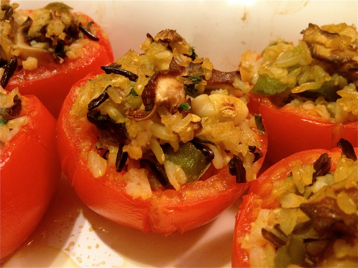 Oven roasted tomatoes filled with wild rice  and mushroom pilaf